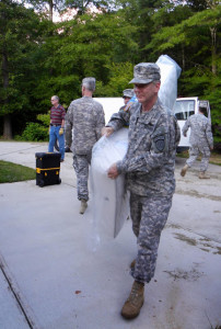 SFC Larry Long, 3BN/1BDE, carries  a new mattress donated by the GSDF.