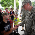 CSM Ron Simmons, 3BN/1BDE, presents a Third Battalion Challenge Coin to returning soldier SPC Samuel Walley.
