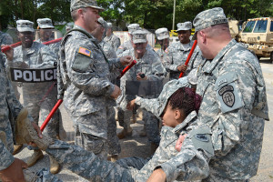 CPL Chris Treadwell assists in moving National Guard simulated casualty from the line.