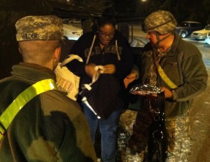 CPT Don Lankford and National Guard soldier Wilder assisting citizens during the operation.