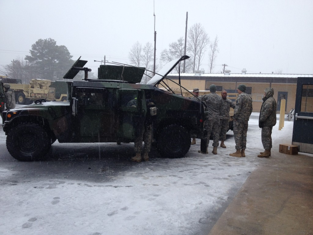 GSDF and National Guard troops loading a HMMWV with water and MRE's.