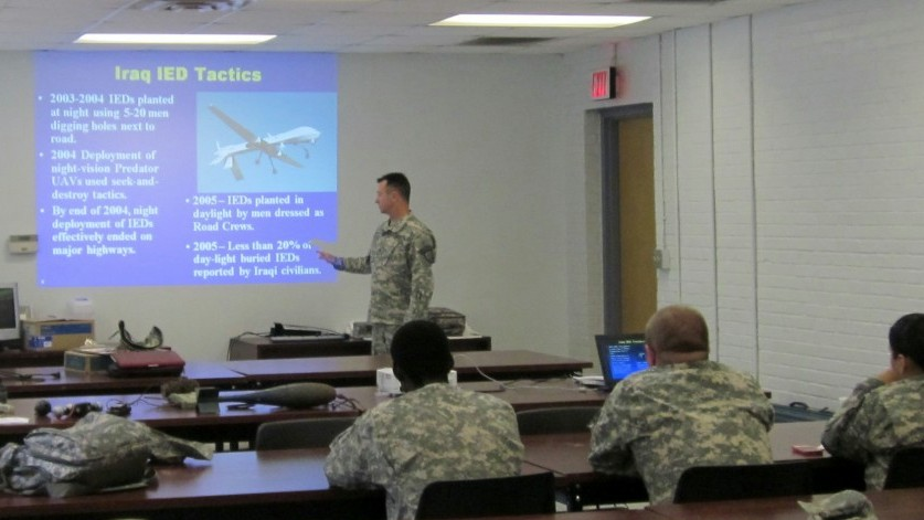 PFC Howard Seay, Headquarters, 5th Brigade instructs counter-IED techniques to members of the 1177th Transportation Company, Georgia Army National Guard.