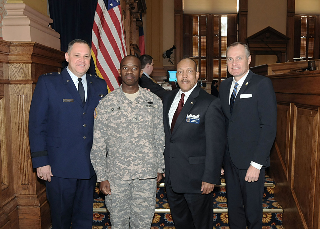 Left to right: MG James B. Butterworth, WO1 Raymond Clunie, State Senator Ronald B. Ramsey, Sr. (D-Lithonia), and Lieutenant Governor Casey Cagle on the floor of the State Senate.