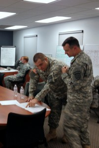 PFC Kerry Hatcher and CPL Howard Seay working in the TOC monitoring operations at Task Force Decatur.