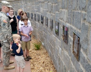 Visitors tour the Freedom Calls Memorial and read the names of the fallen. Photo by Master Sgt. Mark Woelzlein.