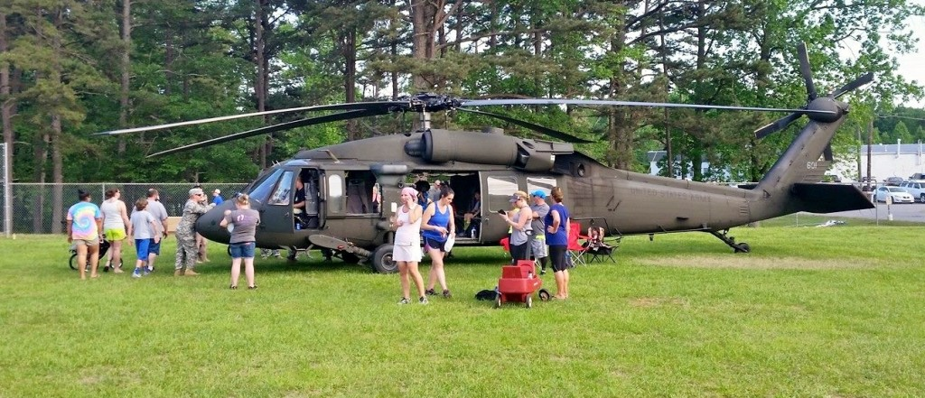 A U.S. Army UH-60 Black Hawk helicopter on display at the event.