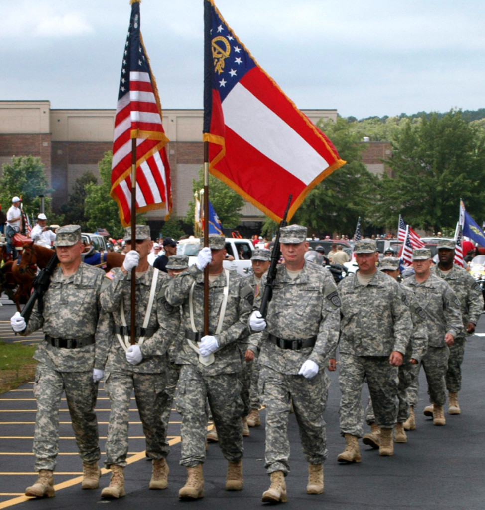 Members of 3BN/1BDE present the colors to commence the 22nd Annual Memorial Day Parade in Dacula.