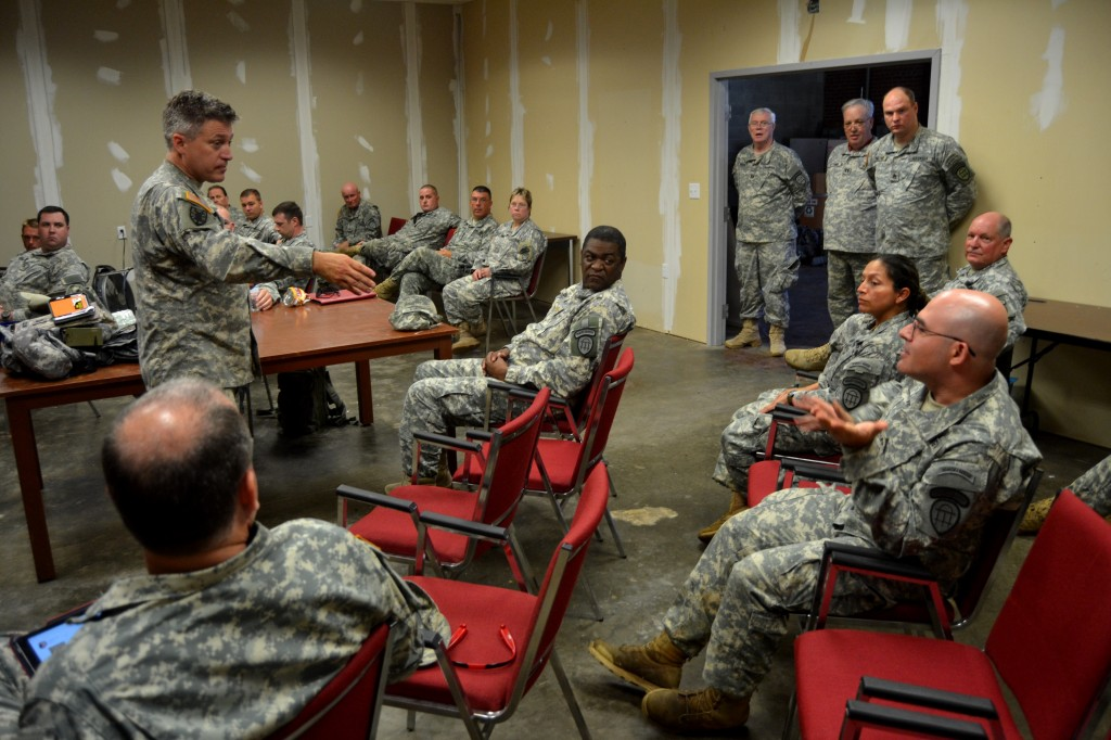GEORGIA NATIONAL GUARD CENTER, Rome, June 6, 2015 – Capt. Hayden Collins, the Executive Officer of 1st Battalion, 1st Brigade, Georgia State Defense Force (GSDF) conducts a brief After Action Report with Soldiers of 1st and 4th Battalion about the morning missions during Defender Northwest Georgia Field Training Exercise (FTX) 2015. This report, along with others gathered throughout the FTX, will determine the training the Soldiers will do during future drills. The FTX tests the capabilities of the Soldiers and staff of the GSDF in their ability to respond to a disaster. (Georgia State Defense Force photo by Master Sgt. Mark D. Woelzlein, Public Affairs Office)