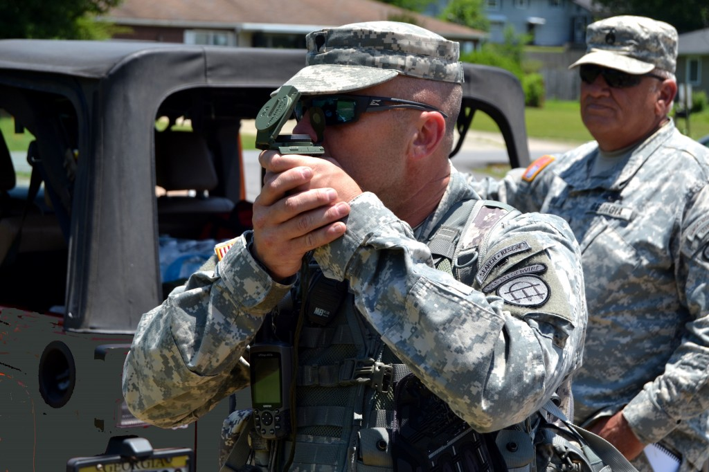 ETOWAH PARK, Rome, June 6, 2015 – Spc. Michael Elliott, a Soldier of the combined Search and Rescue Teams of the 1st and 4th Battalion, 1st Brigade, Georgia State Defense Force (GSDF) takes an azimuth reading through his lensatic compass during Defender Northwest Georgia Field Training Exercise (FTX) 2015. He is guiding his fellow team members on a search for evidence that a tornado survivor passed through the area, insuring that no ground is overlooked. The FTX tests the capabilities of the Soldiers and staff of the GSDF in their ability to respond to a disaster. (Georgia State Defense Force photo by Master Sgt. Mark D. Woelzlein, Public Affairs Office)