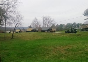 M1088 trucks moving heavy loads during OPB15.