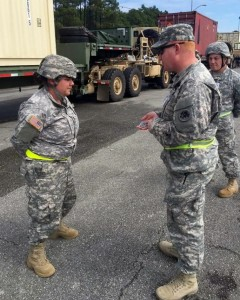 SSG Kimble is presented a  Challenge Coin.