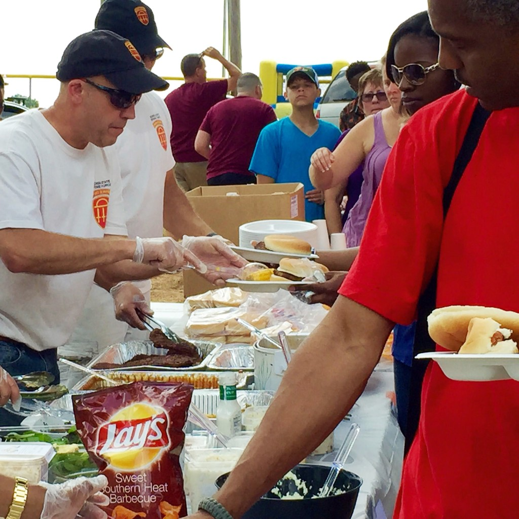 DOBBINS ARB, Marietta, Georgia, August 9, 2015 – Soldiers from the 76th Support Brigade serve food at the 78th Aviation Troop Command Family Day event.