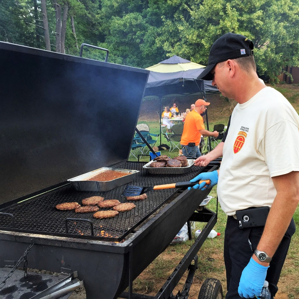 DOBBINS ARB, Marietta, Georgia, August 9, 2015 – A Soldier from the 76th Support Brigade cooks food at the GAARNG 78th Aviation Troop Command Family Day event.