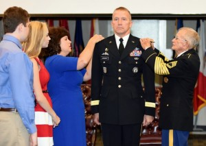 CLAY NATIONAL GUARD CENTER, Marietta, GA, August 24, 2015 – Brigadier General Thomas Carden's family pins the single star of a brigadier general on his right shoulder while Sgt. 1st Class Jimmy Jordan (ret) pins a star on his left shoulder. In 1989, Carden was pinned with his 2nd Lt. rank by his family and Sgt 1st Class Jordan. Photo by Pvt. Alexander Davidson, GSDF