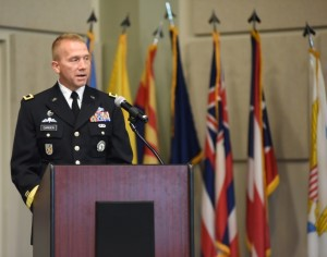 """CLAY NATIONAL GUARD CENTER, Marietta, GA, August 24, 2015 – """"I owe so much to so many people. The reality of today is that it's more about others than it is about me,"""" said newly promoted Brig. Gen. Thomas Carden to current and former members of the Georgia National Guard. Carden asked all retired members of the Georgia National Guard to be stand and recognized. """"This is the house that you built,"""" said Carden. Photo by Pvt. Alexander Davidson, GSDF"""