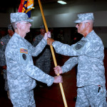COL Brad Bryant (right) passes the Brigade flag to incoming First Brigade Command Sergeant Major Ron Simmons.