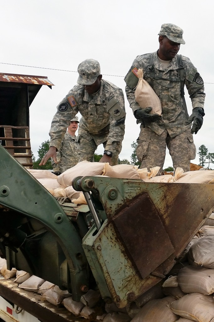 Georgia Army National Guard and Georgia State Defense Force Soldiers work together to load sandbags onto a flatbed truck as part of hurricane relief efforts near Augusta, Georgia. (Georgia State Defense Force photo by Chief Warrant Officer 2 W. Kevin Ward, 1BDE, AS3.)