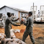 Georgia Army National Guard and Georgia State Defense Force Soldiers work together to fill and load sandbags as part of hurricane relief efforts near Augusta, Georgia. (Georgia State Defense Force photo by Chief Warrant Officer 2 W. Kevin Ward, 1BDE, AS3.)