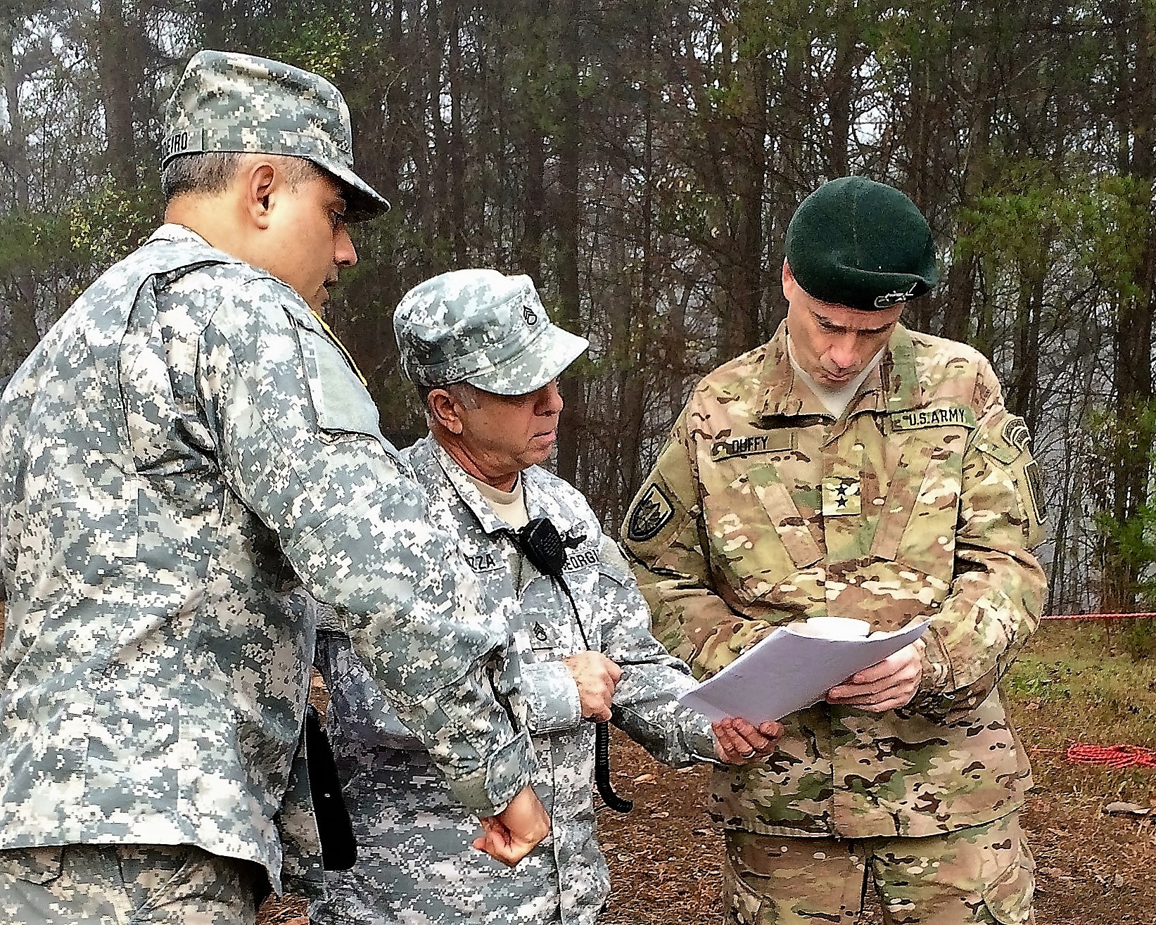 GEORGIA NATIONAL CEMETERY, Canton, Georgia, December 12, 2015 – Capt. Anazion Cordeiro (left) and Staff Sgt. Richard Carrozza (center) provide an overview of Georgia State Defense Force operations to Maj. Gen. William F. Duffy (right). (Georgia State Defense Force photo by Pvt. Michael Chapman, Public Affairs Office)