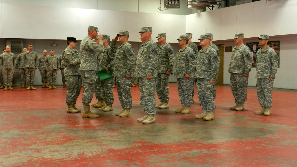 MARIETTA ARMORY, Marietta, Georgia, December 6, 2015 – Capt. Scott Thompson, assisted by Cpl. Melanie Dallas, returns the salute of a Soldier after pinning him with his new rank. (Georgia State Defense Force photo by Pvt. Michael Chapman, Public Affairs Office)