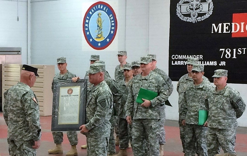 MARIETTA ARMORY, Marietta, Georgia, December 6, 2015 – The graduates of IET Charlie Class present Sgt. 1st Class Rodney Akers with a gift following graduation. It is customary for the graduating class to present a gift to the IET Cadre in recognition of their dedication and service. (Georgia State Defense Force photo by Pvt. Michael Chapman, Public Affairs Office)
