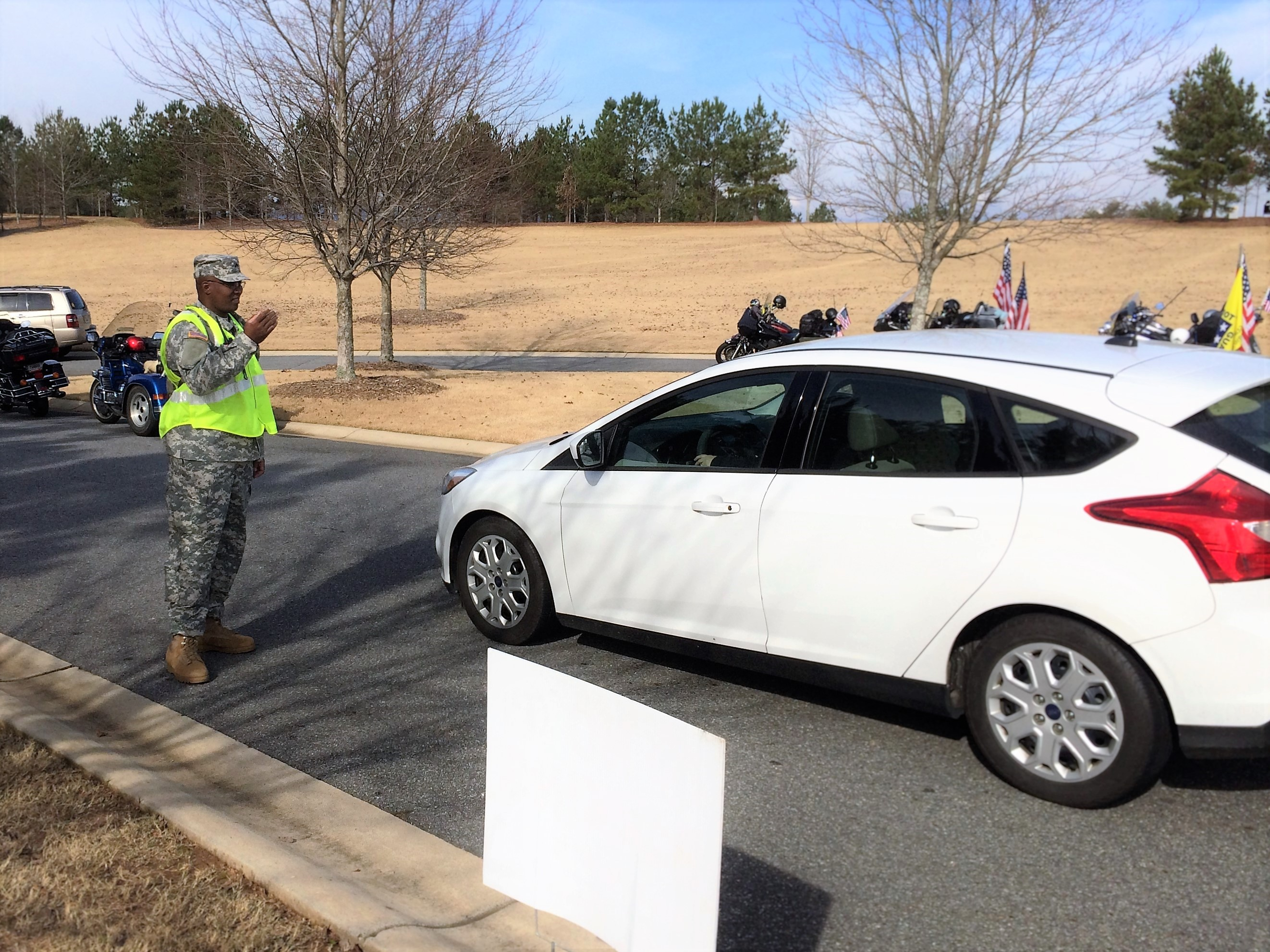 GEORGIA NATIONAL CEMETERY, Canton, Georgia, December 12, 2015 – Cpl. Robert Williams from 1st Brigade directs traffic during the event. (Georgia State Defense Force photo by Pvt. Michael Chapman, Public Affairs Office)