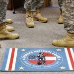 Members of the GSDF gather near the National Guard-themed rug at Clay National Guard Center. The rug is displayed in the GSDF headquarters building. Georgia State Defense Force Photo by Pfc. Alexander Davidson