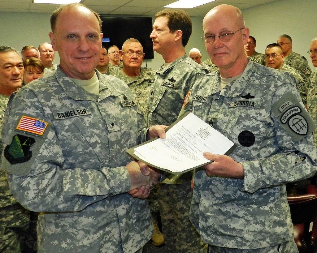 Brig. Gen. Tom Danielson, GSDF commander, presents the Georgia State Defense Force Meritorious Service Medal to Staff Sgt. Richard Legrand. Georgia State Defense Force photo.