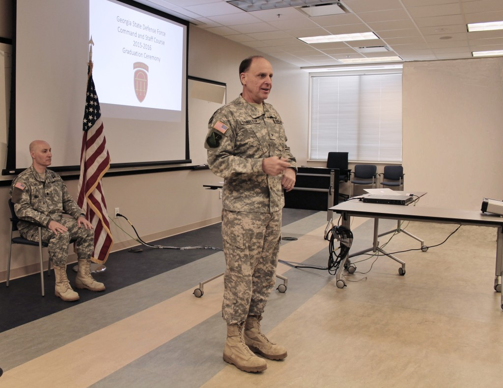Lt. Col. Allen Vance, Deputy Commander, TRADOC (left), introduced GSDF Commander Brig. Gen. Thomas Danielson (right, foreground), who addressed 2015–2016 graduates of the GSDF Command and Staff Course. Georgia State Defense Force photo by Pvt. Beverly Shepard, Public Affairs Office