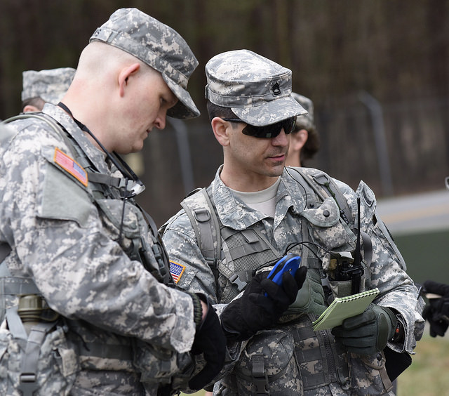 LAKE LANIER, Buford, Ga. March 19, 2016 – Sgt. 1st Class Tavares and Sgt. 1st Class Weeks of the Georgia State Defense Force (GSDF) verifying the reconnaissance data as they prepare to send out teams during the Lake Lanier Search and Rescue Exercise (SAREX), involving a mock airplane crash scenario. The GSDF, Civil Air Patrol, and United States Coast Guard Auxiliary participated in this Multi-Agency Search and Rescue Mission. Georgia State Defense Force photo by Pfc. Davidson