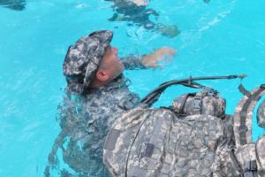 "GSDF soldiers practice the ""hanging float"" as part of water survival training.  This technique can be used while waiting for help to arrive and as a resting position when swimming to safety.  Georgia State Defense Force Photo 