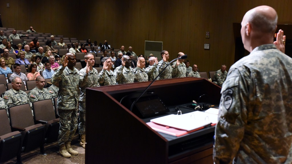 Lt. Col. Vance, Deputy Commander of Training and Doctrine Command, administers the oath of office to the graduates of the combined Officer Candidate/Warrant Officer Candidate School at the Georgia Public Safety Training Center in Forsyth, Georgia on August 14, 2016. (Georgia State Defense Force photo by Pfc. Davidson)
