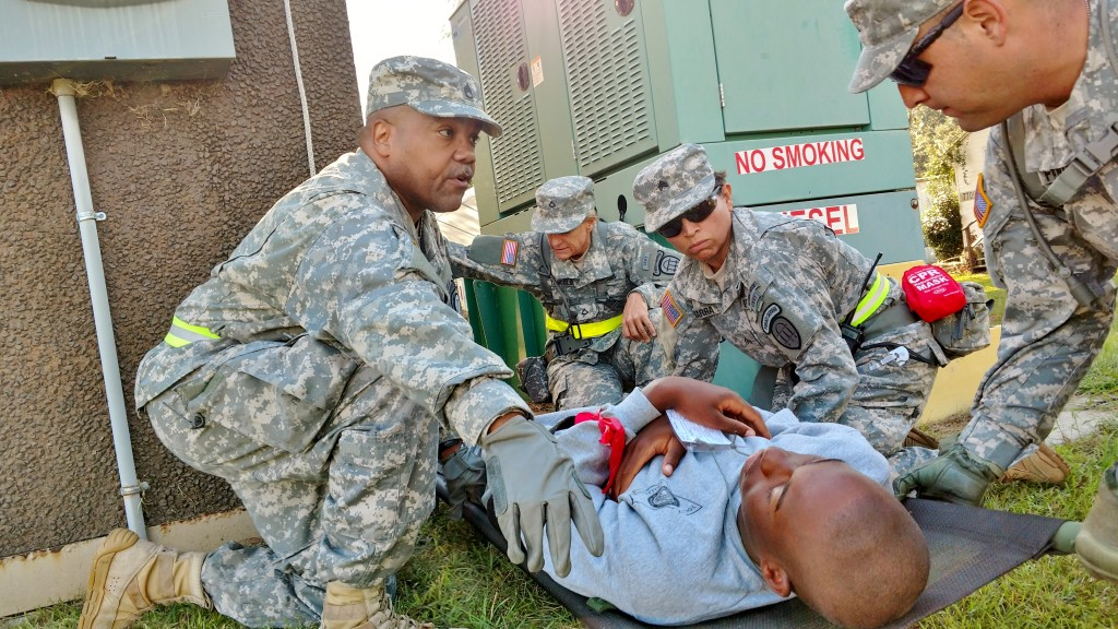 Georgia State Defense Force Soldiers render aid to a mock casualty during Annual Training at Fort Stewart, Georgia on October 1, 2016. (Georgia State Defense Force photo by Pfc. Alsdorf)
