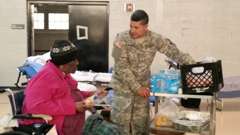A member of the Georgia State Defense Force provides lunch to an evacuee displaced by Hurricane Matthew at Tubman Education Center in Augusta, Georgia on October 10, 2016. (Georgia State Defense Force photo by Sgt. Ibarra)