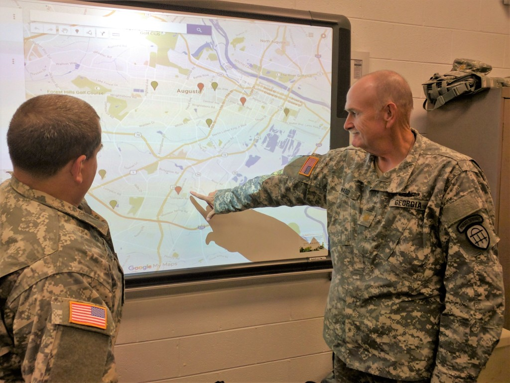 Maj. Ward (right) points out a shelter location to Staff Sgt. Blalock (left) in the Tactical Operations Center at Tubman Education Center in Augusta, Georgia on October 9, 2016. (Georgia State Defense Force photo by 2nd Lt. Hughes)