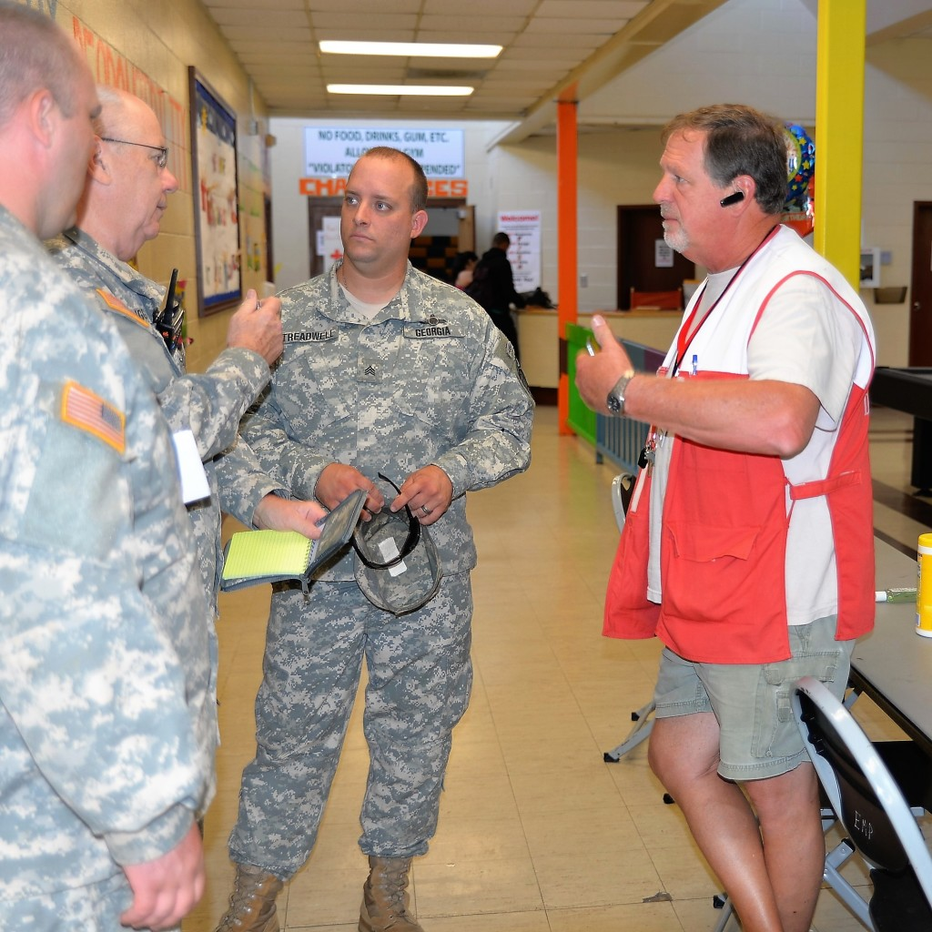 Members of the Georgia State Defense Force coordinate with a member of the American Red Cross at the East Macon Recreation Center in Macon, Georgia during the response to Hurricane Matthew on October 8, 2016. (Georgia State Defense Force photo by Sgt. 1st Class Alasa)
