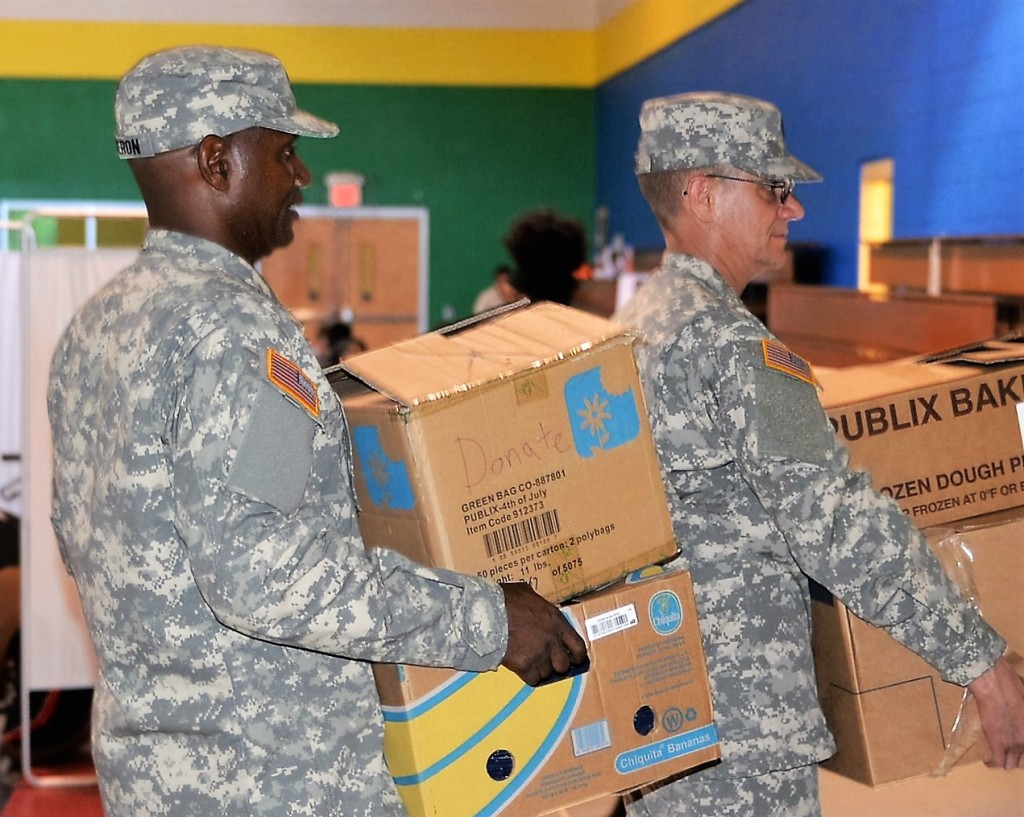 Members of the Georgia State Defense Force move supplies at the Hephzibah Children's Home in Macon, Georgia during the response to Hurricane Matthew on October 8, 2016.  (Georgia State Defense Force photo by Sgt. 1st Class Alasa)