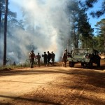 GSDF members respond to a fire during an OPFOR mission at Fort Benning, Georgia, April 1, 2017. The immediate response of GSDF personnel helped prevent the fire from spreading and allowed the training mission to continue. Georgia State Defense Force photo by Staff Sgt. Amber Kimble
