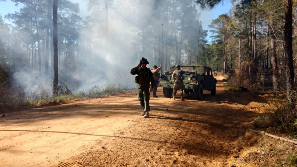 During an OPFOR mission, GSDF Soldiers pull their resources together to help control and safely extinguish a fire that threatens the Infantry Training Area at Fort Benning, Georgia, April 1, 2017. Georgia State Defense Force photo by Staff Sgt. Amber Kimble
