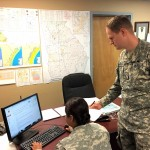 Chief Warrant Officer 2 Daniel Mayer, right, and Pfc. Anitha Guruswami monitor incoming information and activities in the Georgia State Defense Force Mobile Operations Center during Vigilant Guard 2017 at Clay National Guard Center in Marietta, Georgia, March 28, 2017.  Georgia State Defense Force photo by Warrant Officer Oscar Cano