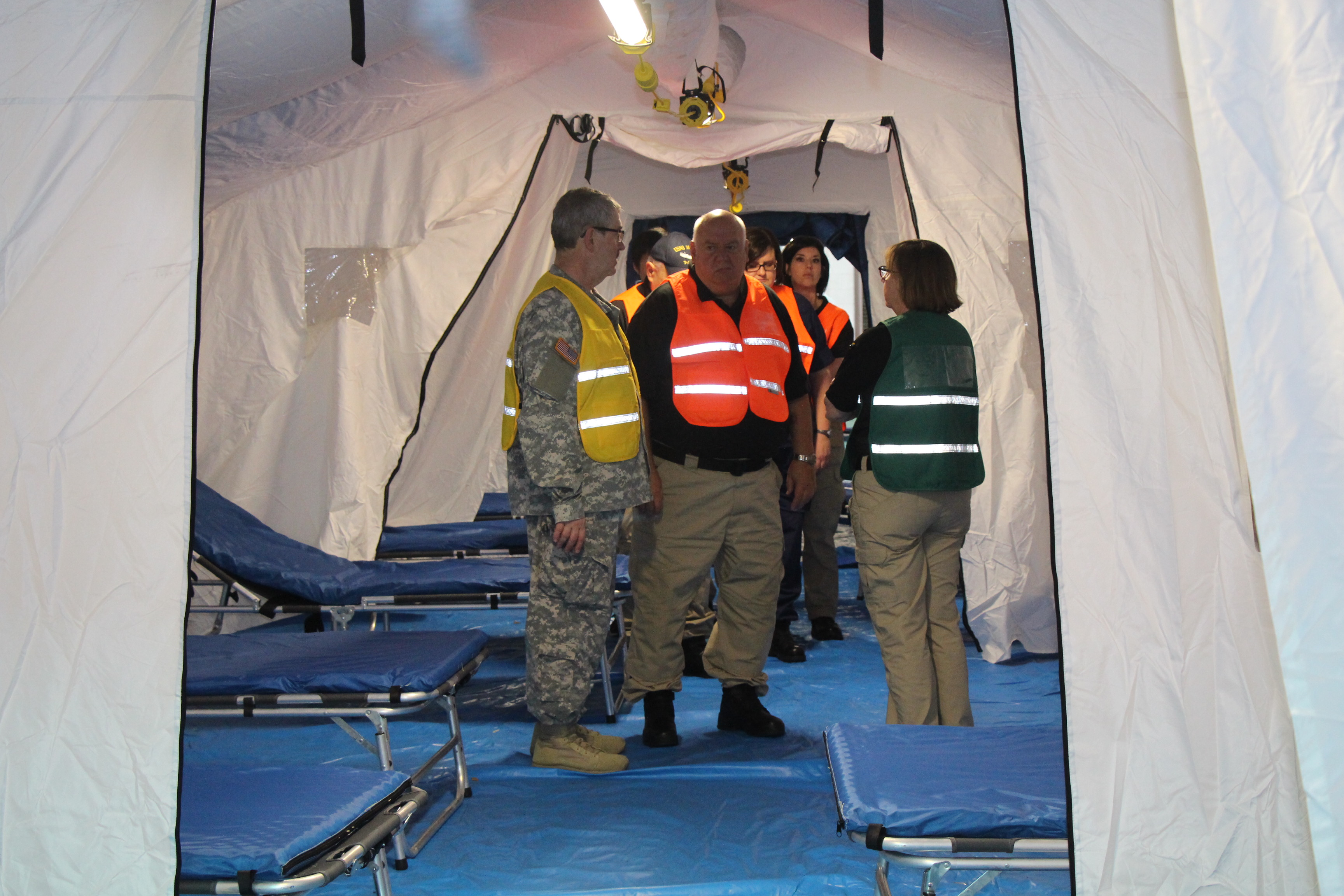 GA SDF Chief Surgeon Lt. Col. Michael Greene (left) and Medial Reserve Corps Director Col. John S. Harvey (center) are inspecting the Mobile Surge Hospital on March 29, 2017, as it was set up at Air Dominance Center in Savannah, GA, and prepared for the disaster casualties (role players) arrival during the Vigilant Guard 2017 exercise. Vigilant Guard 2017 Georgia is a multi-state multi-agency training exercise, sponsored by U.S. Northern Command, in collaboration with the National Guard Bureau.  Georgia State Defense Force photo by Capt. Vadim Timchenko.
