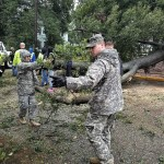 Members of 1st Brigade, Georgia State Defense Force, help local authorities clear debris from the road in the wake of Hurricane Irma. Georgia State Defense Force photo by Sgt. Sandra Ibarra