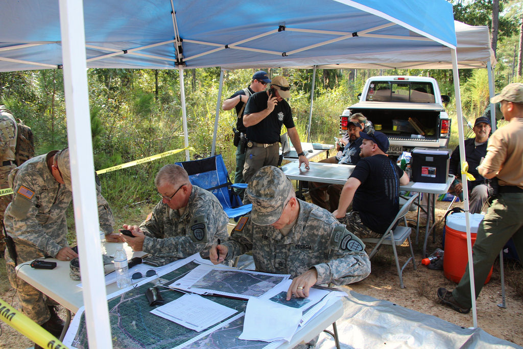 Members of the Georgia State Defense Force review maps and establish search parameters before embarking on a daylong, multi-agency search and rescue mission in east Georgia, September 18, 2017. Georgia State Defense Force photo by Pfc. Andreas Alsdorf