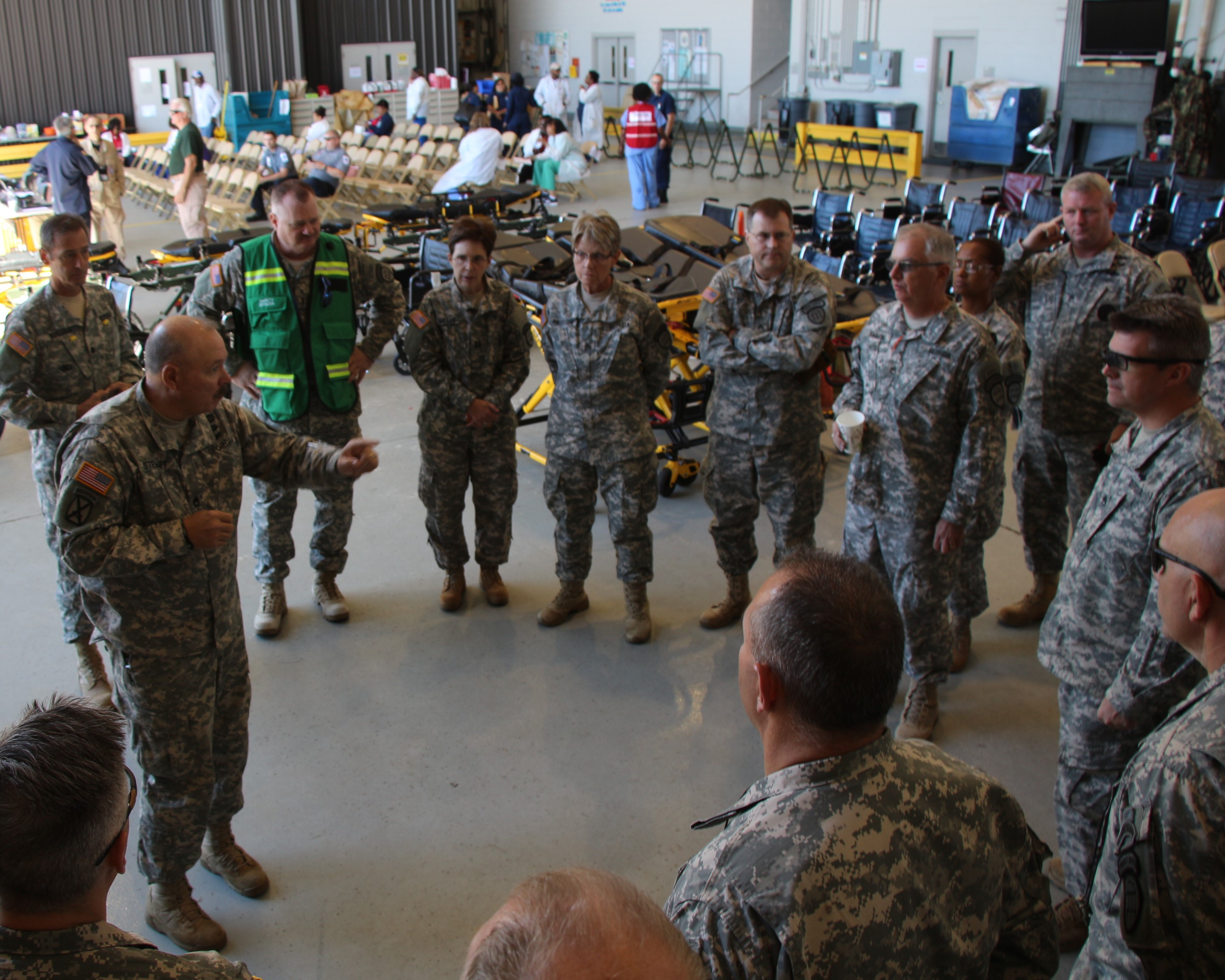 Sergeant First Class Steven Stewart briefs Georgia State Defense Force soldiers with the task details before assigning them to upload evacuees from the C-130H aircraft, who were transported to Dobbins Air Reserve Base, Marietta, Georgia from the U.S. Virgin Islands and Puerto Rico in the aftermath of Hurricane Maria, Oct. 1, 2017. Georgia State Defense Force photo by Maj. Vadim Timchenko